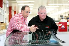 Micheal Hajj (left), Technical Manager for Adhesive Technologies, Henkel ANZ, and Steven Dew (right), Assistant General Manager for Sales, Henkel Australia, inspecting a windscreen at Kilsyth.
